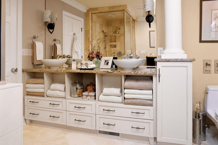 Hide the Plumbing - 65 Calming Bathroom Retreats - Southernliving. Required plumbing parts don't have to ruin your under-sink open shelf look. Open cubbies below these two bowl sinks have removable panels in the back to allow access to pipes.  See this Master Bath Makeover