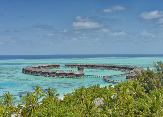 A superb, all-inclusive overwater villa stay with outdoor Jacuzzi at a traditionally designed Maldives resort - travel included