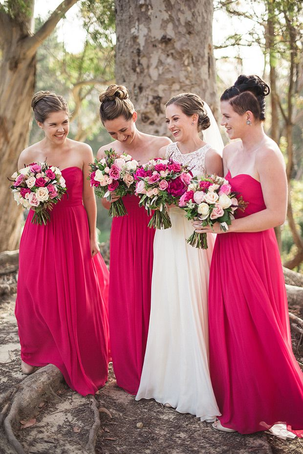 Pink bridesmaids dresses | Maria and Mark's pretty in pink and floral wedding by Meridith Lord Photography | www.onefabday.com