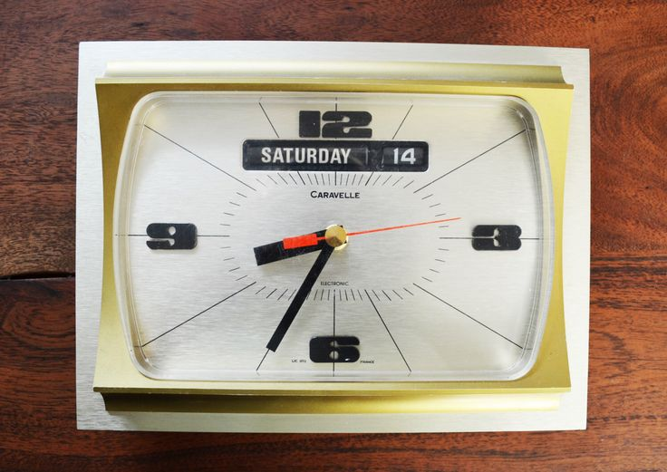 Caravelle Mid Century wall Clock; rectangle Shaped - Vintage brass and gold with date and time feature by Trashtiques on Etsy https://www.etsy.com/ca/listing/471832831/caravelle-mid-century-wall-clock