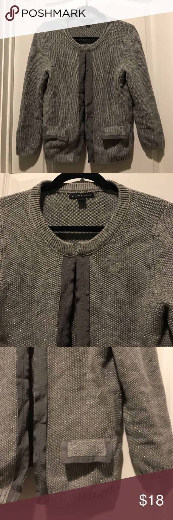 Banana Republic Short Silver Cardigan Like new! No damages, stains, or wearing. Has hooks all the way down the front. Silver thread woven into the cotton knit. Banana Republic Sweaters Cardigans