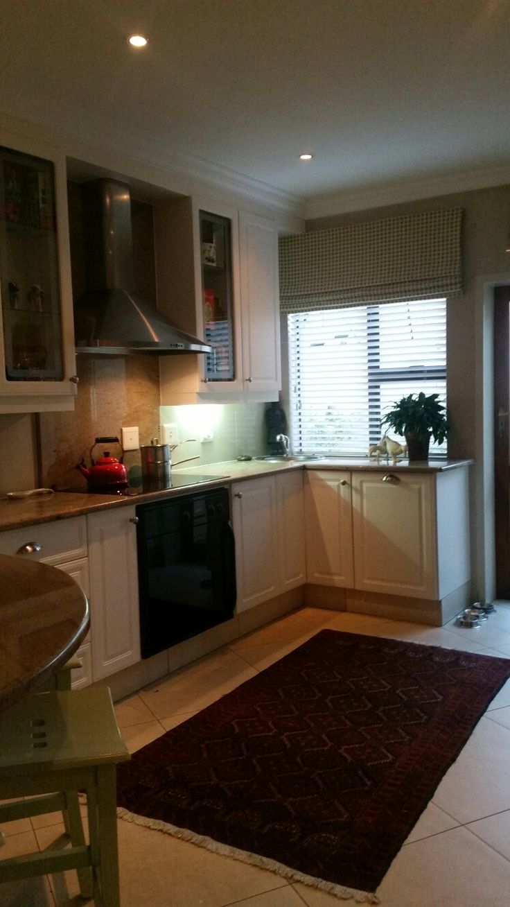 Painted existing cupboards, new handles, new wooden blinds and mock blinds above it ...A new kitchen emerged...