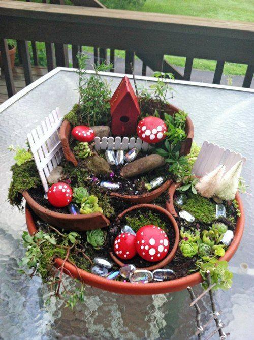 Broken pot garden by Cathy Strate at http://www.fleamarketgardening.org/2013/07/16/fairy-garden-magic/