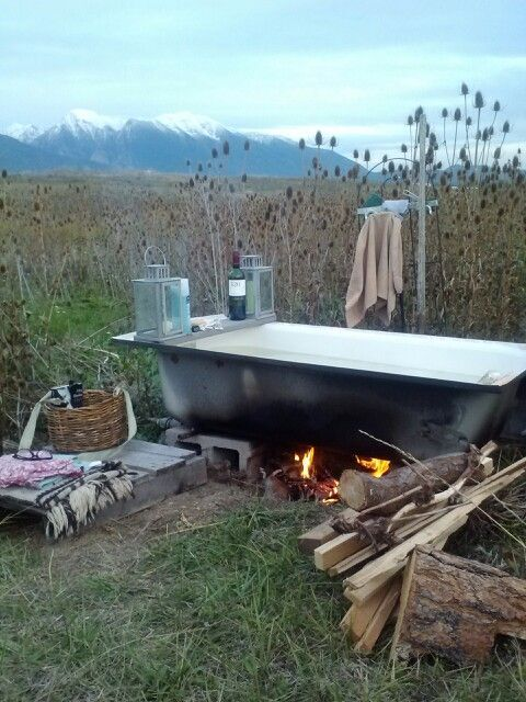 This looks perfect. Just like what I had in mind, up on cinder blocks and everything. I like the board across the bath to rest a drink on.