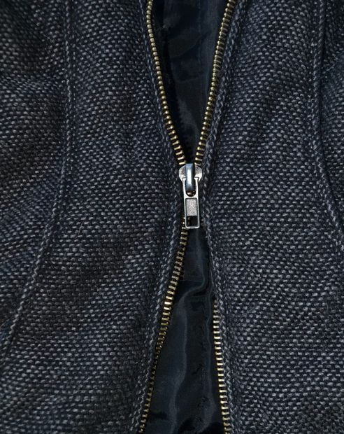 Fix a zipper. FYI getting the two top clips off is not easy. but don't give up. also when u put the zipperhead back on start on the top of the right side (if ur looking at the front of the jacket).
