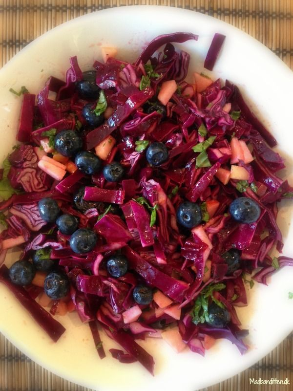 Red kale salat with blueberries and basil.