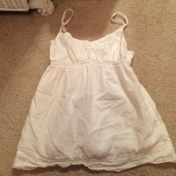 Aeropostale white tank top Pretty beaded top that goes with everything the straps are adjustable size XS no rips stains or tears Aeropostale Tops Tank Tops