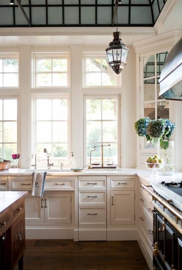 I will never get over this super famous and super beautiful kitchen with an incredible glass and iron ceiling in a Westport, Connecticut home by Austin Patterson Disston.