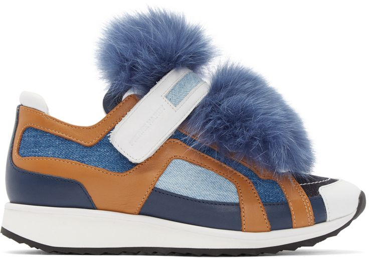 Low-top buffed leather and denim sneakers in white, camel, and tones of blue. Round toe. Velcro strap at ankle. Lace-up closure. Detachable fox fur accent at vamp. Rubber sole in white and black. Tonal stitching.