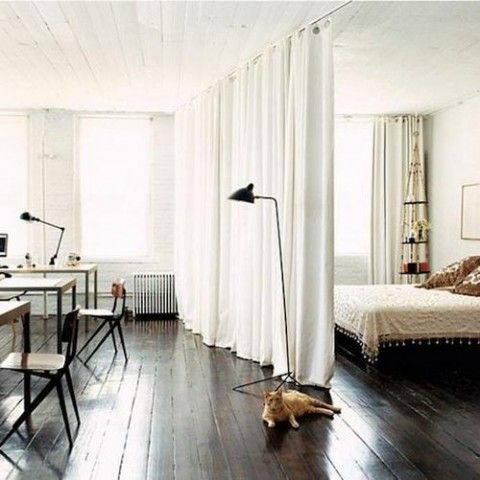 Use curtains to separate office and guest room in upstairs loft