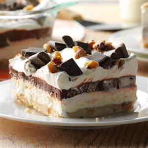 Easy Four-Layer Chocolate Dessert Recipe -I grew up on these nutty, chocolatey layered treats. Now I make them for both my mom and myself, since I know she loves them, too. —Kristen Johnson, Waukesha, Wisconsin