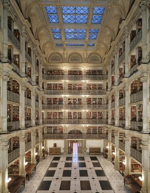 "The George Peabody Library at Johns Hopkins University in Baltimore, Maryland. Completed in 1878, the library was designed by Baltimore architect Edmund G. Lind to be a ""cathedral of books."" The neo-Grec interior features an atrium that, over a black and white marble floor, soars 61 feet to a latticed skylight surrounded by five tiers of ornamental cast-iron balconies and gold-scalloped columns. In 2002-2004, the library underwent a U$S1 million renovation."