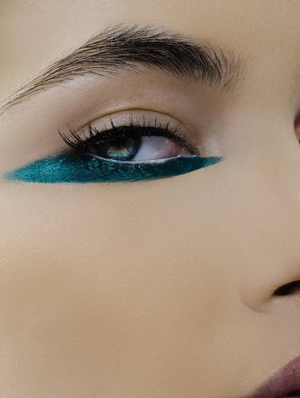 Interesting streak of eyeliner on the bottom lid. [Makeup by Theresa Francine]