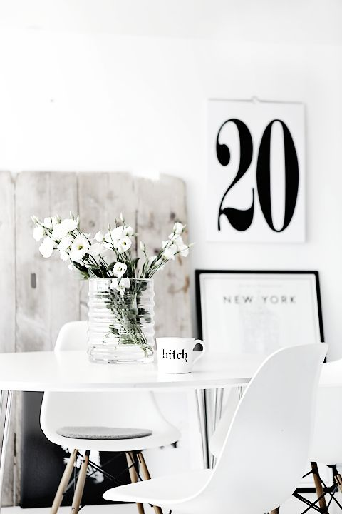 White decor palette shite flowers chair and table print frame New York vase of white flowers
