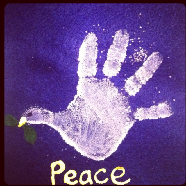 Handprint dove. Hang using a wooden dowel ribbon.