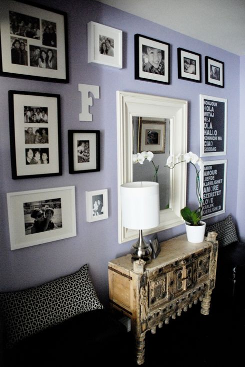 """i like the family pictures displayed on the wall w/ the """"hello"""" print and """"love"""" print"""