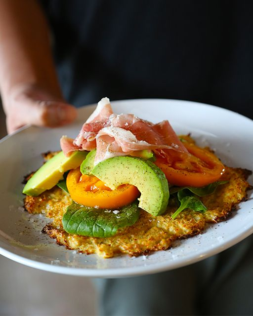 A cauliflower crust replaces the traditional flatbread for a healthier and delish dish!