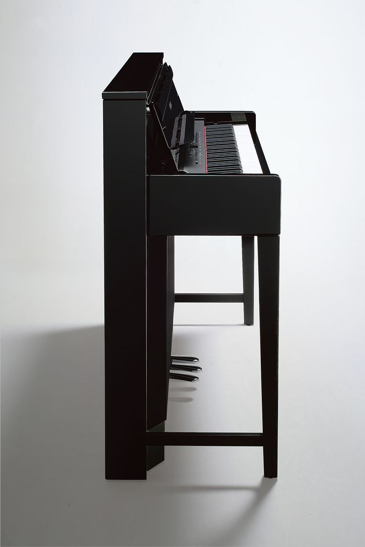 Clavinova digital piano in polished ebony. Slim profile to fit in even the tightest places of your home.