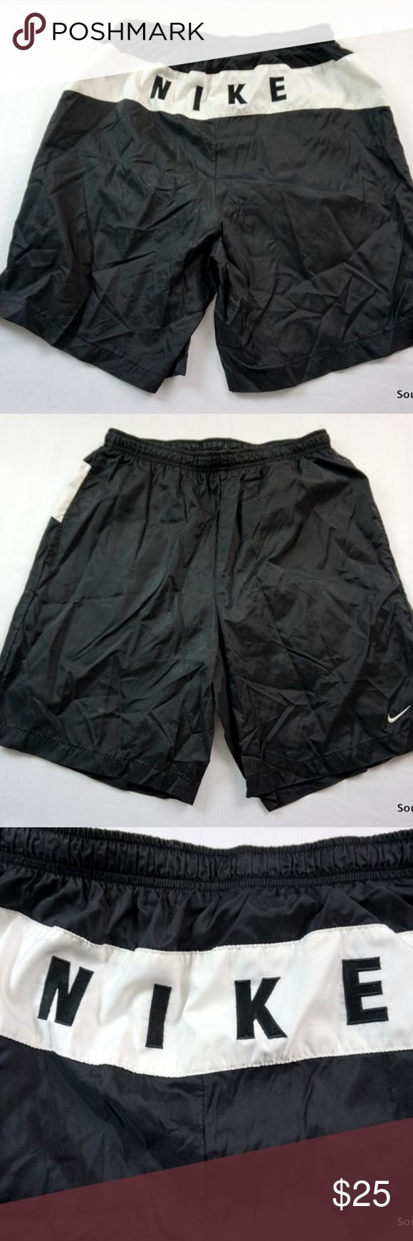 """VTG Nike Swim Shorts Spellout Script Logo Large Vintage 90s Nike Script Spellout Black Swim Trunks Men Large Embroidered 1990s Rare Design Swim Shorts Swimming Shorts 90s Fashion  Brand:  Nike Size:     Men's  Large Color:   Black Material: Body 100% Polyester, Lining 100% Nylon   Detailed Measurements: (Front Side of Garment has been measured laying flat on a table)  Waist:    30"""" inches (measured flat, front side) Inseam:  8 """" inches Length:  19""""inches Nike Swim Swim Trunks"""