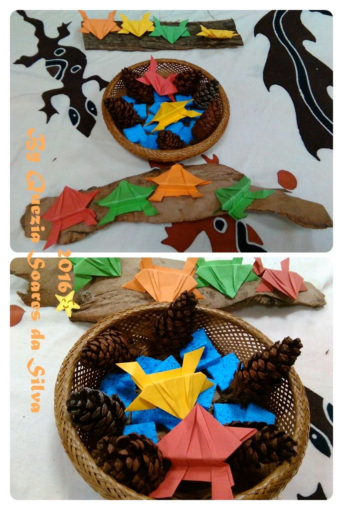 "Following the children's interest on ""Five little speckled frogs"" song I made origami frogs. The pool was blue sponges. The log was bark. I added some pinecones as well."
