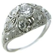 20th century circa 1930, late Art Deco era, platinum domed filigree ring featuring a center 4-prong set round transitional brilliant cut diamond weighing 0.47ct of SI2 clarity and H color.