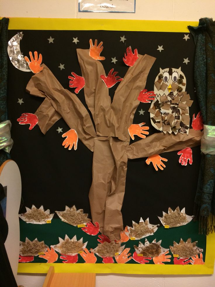 Autumn display at nursery - Hedgehogs made from shredded wheat and glue. Owl collage and moon collage. Children's handprints