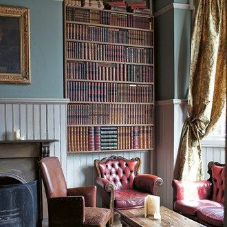 Ornately shabby chic bookshelves, squashy sofas and decorative wallpaper.