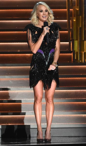 Carrie Underwood hosting the 50th annual CMA awards wearing a 1980's inspired look.