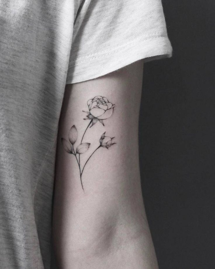 "stickandpoketattoo: ""Hand poked rose tattoo on the left bicep. Tattoo Artist: Lara M. J. """