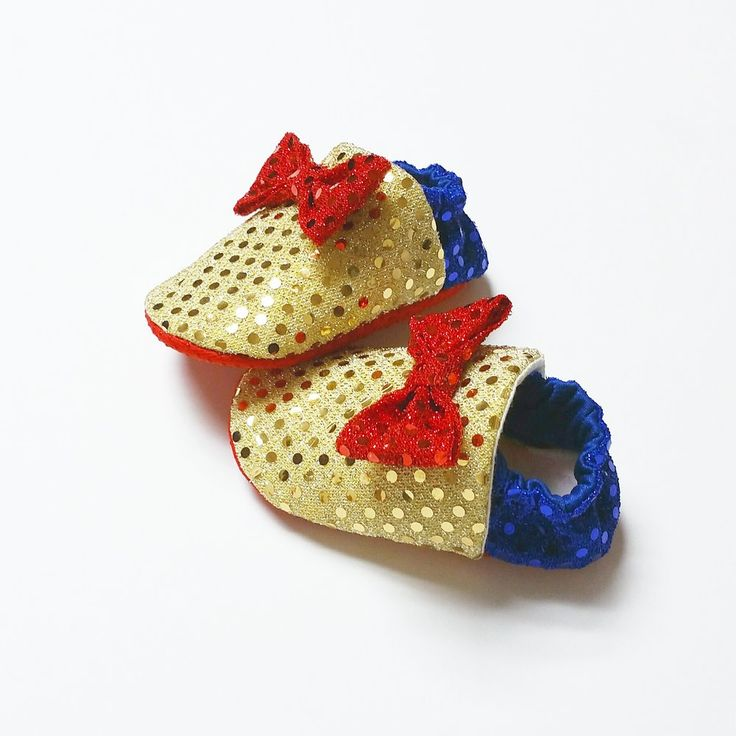 Snow White themed, sequined, soft soled baby shoes. Our shoes are all handmade with non slip soles and a soft velvety insole. Our Snow White shoes come with red soles and a red sequin bow.