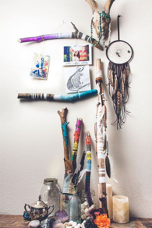 Make a little frame using painted tree branches. Knot the string and use paper clips(or clothes pins) to attach the photographs, then hang it on your wall. You can do so many things with these painted beauties. http://hative.com/diy-ideas-with-twigs-or-tree-branches/