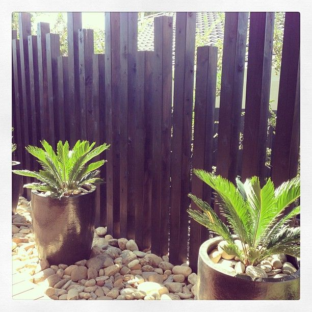 I love this fence which doubles as garden art.
