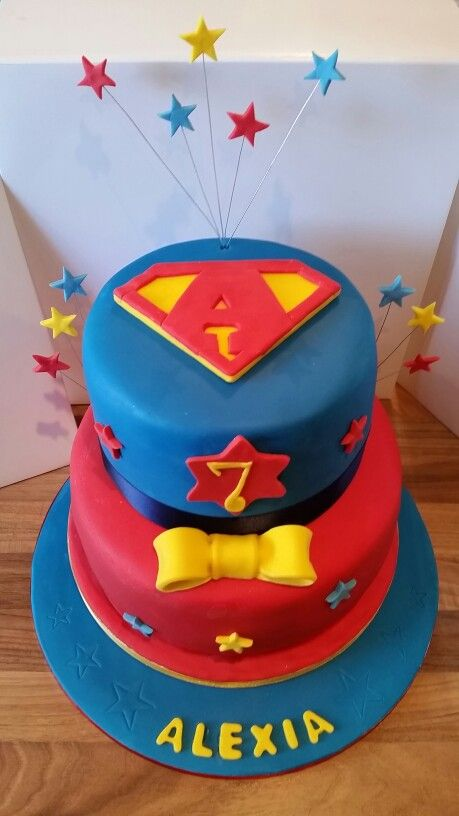 Supergirl themed 2 tier cake made by a talented Maisie Cakes apprentice.