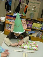 Elf hat - tie in with our classroom elf.  Take a picture of each child in the elf hat.  Writing prompt - if I was one of Santa's elves I would...