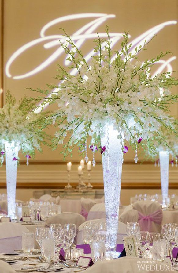Tall white orchids wedding centerpiece idea