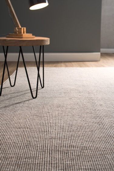 Thames - This hard-wearing flat weave rug made of 100% wool has a subtle and natural look but with just the right amount of pop. It doesn't take over a room but still makes its mark.