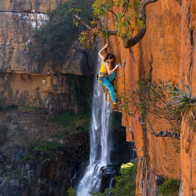 """Paige Claassen (@paigeclaassen) works her way up alongside Boven Waterfall on """"As the World Disappears"""" (5.12c) in South Africa.  Photo: Arjan de Kock (@arjandekock)"""