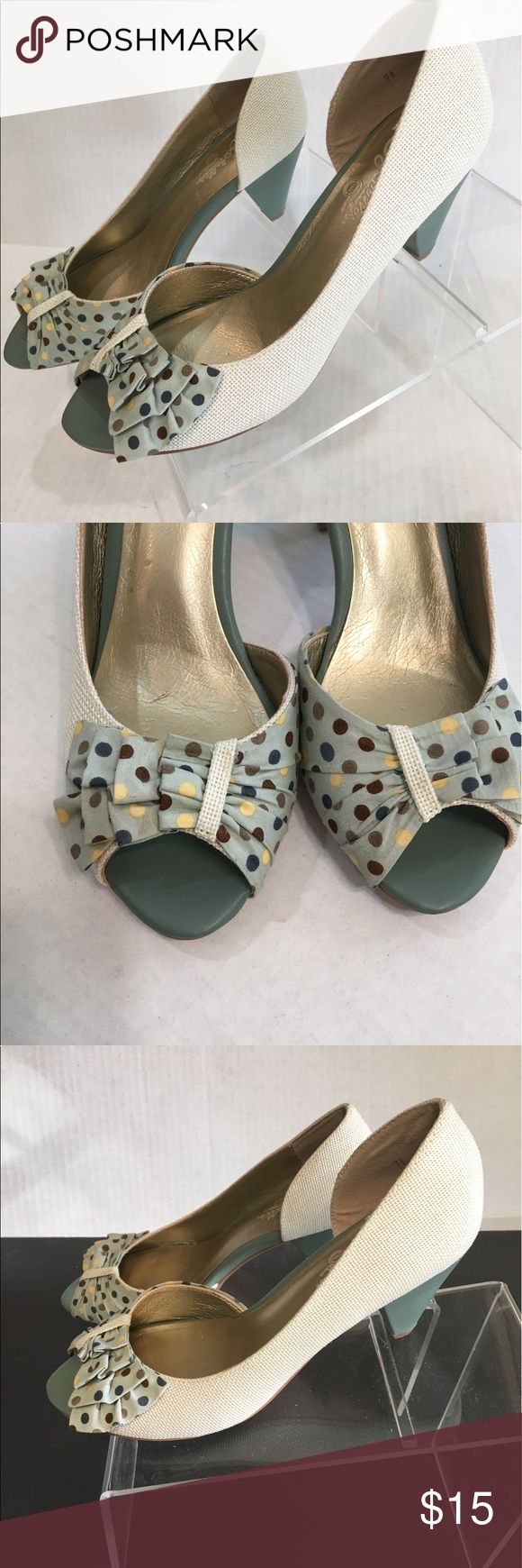 """Seychelles Polka Dot Heels These shoes could not be any cuter!  Cream colored fabric shoes with aqua heels and polka dot upper. Top is pale aqua ruffle with brown, taupe, teal, and yellow polka dots. Shoes are in excellent condition with no visible marks--very clean. Stacked cone-shaped heel is approx 3"""". Seychelles Shoes Heels"""