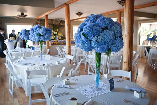 Sky blue wedding centrepiece flowers table