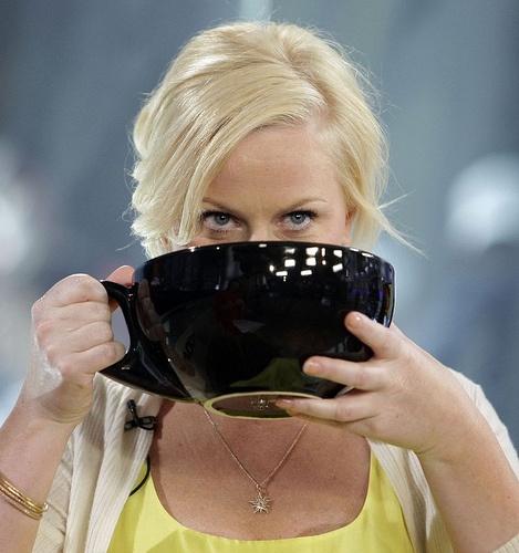 Amy poehler, large coffee mug, pose.  Every Monday Morning.