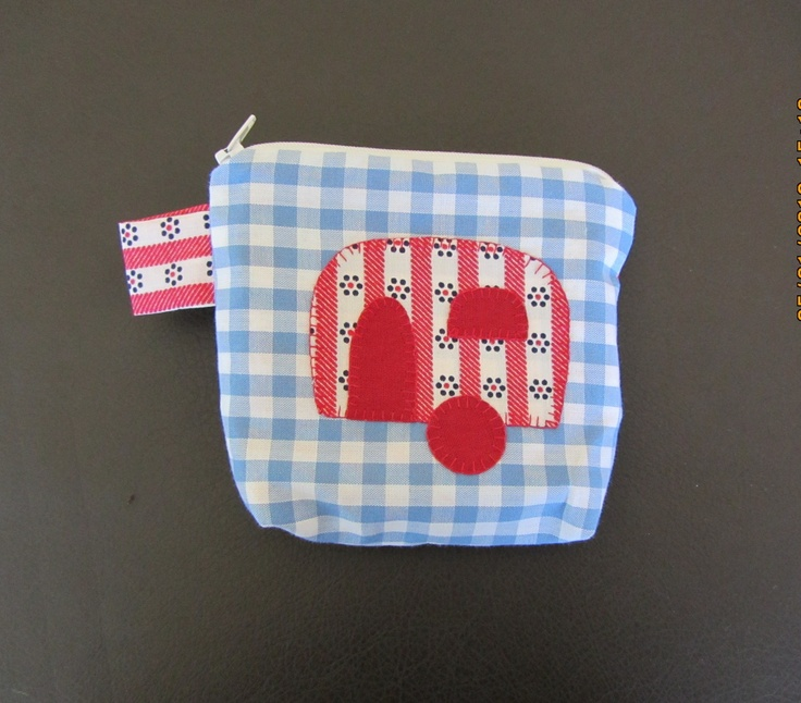 a little purse with a caravan applique feature for makeup, coins or whatever you need to carry