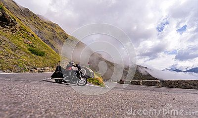Motorcyclist on the dangerous curves of famous Passo Stelvio. Dolomite Alps. Italy