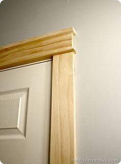 DIY craftsman door and window trim. So simple, it only takes about 15 minutes!