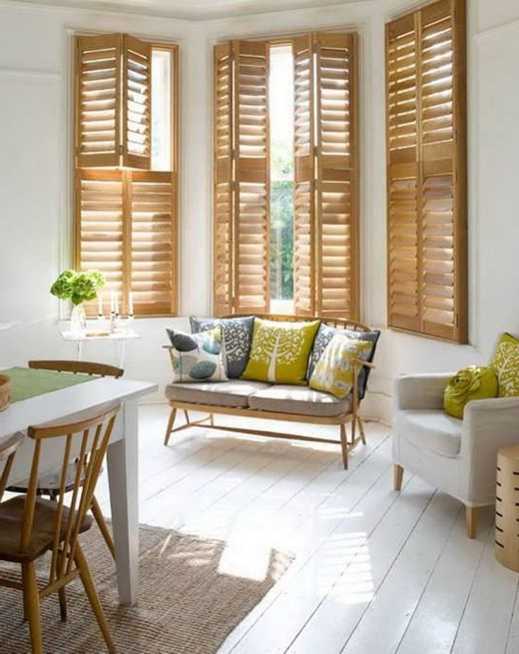 Natural shutters with white casing. A somewhat rustic and warmer look for shutters.