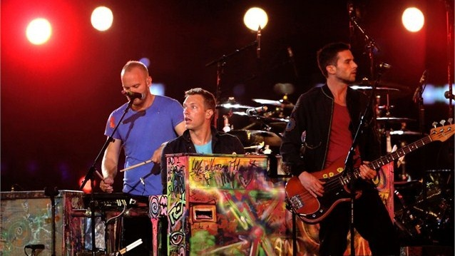 (R-L) Guy Berryman, Chris Martin and Jonny Buckland of Coldplay perform on the central Sundial Stage during the Paralympic Games Closing Ceremony.