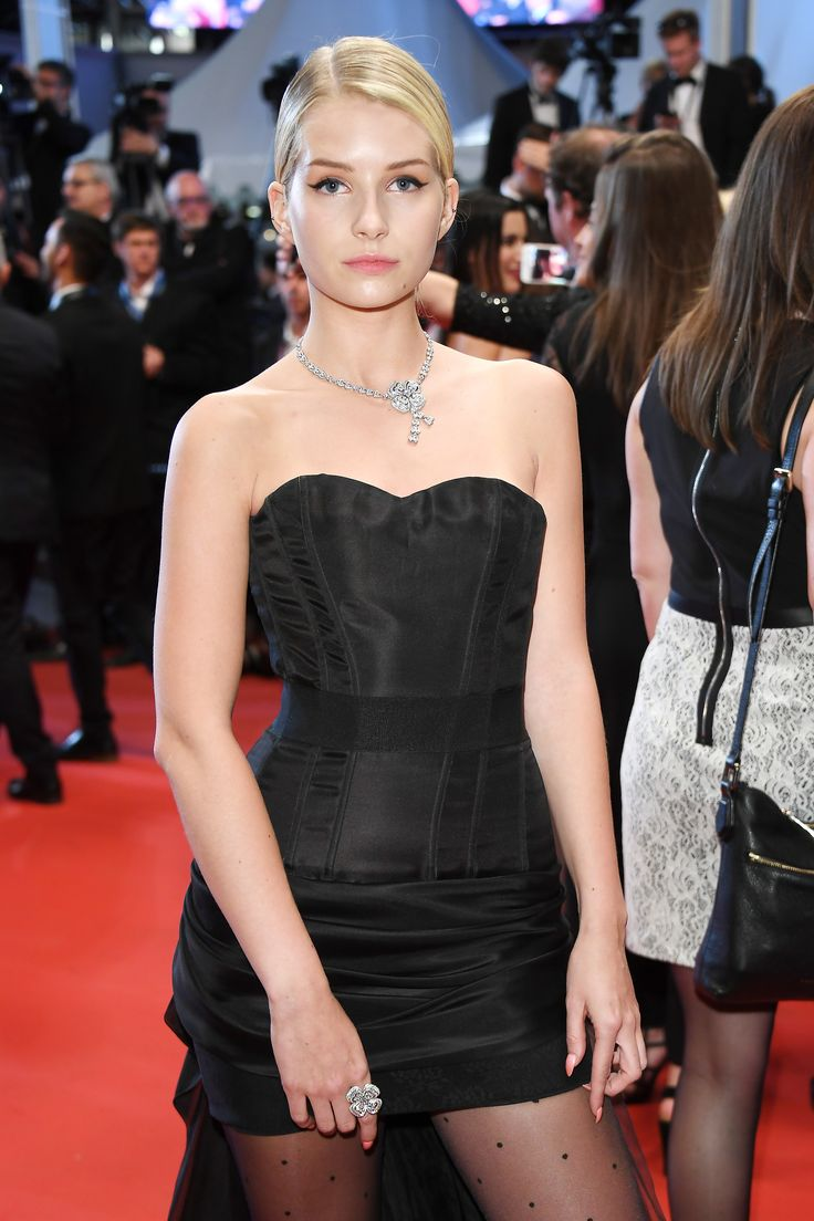 Lottie Moss, sister of Kate Moss, wore a floral Bulgari diamond high jewellery necklace and matching ring, with chic black eye liner flicks and a strapless love heart neck black LBD and polka dot tights. For glamour celebrity fashion Cannes Film Festival red carpet jewellery spotting travel here: http://www.thejewelleryeditor.com/jewellery/top-5/best-red-carpet-jewellery-jewelry-cannes-film-festival-2017-weekend/ #jewelry