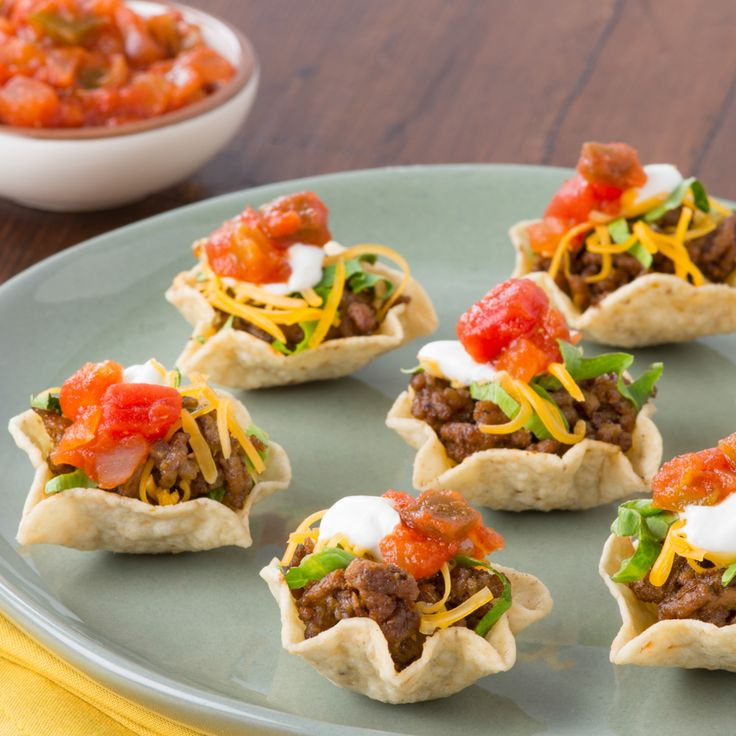 Taco Night in One Bite - Tacos just became an appetizer! With the genius Tostito Scoops everyone can have a bite, or two or three, of taco without any mess. Perfect for entertaining during the holidays! #InspiretheSeason #Ad