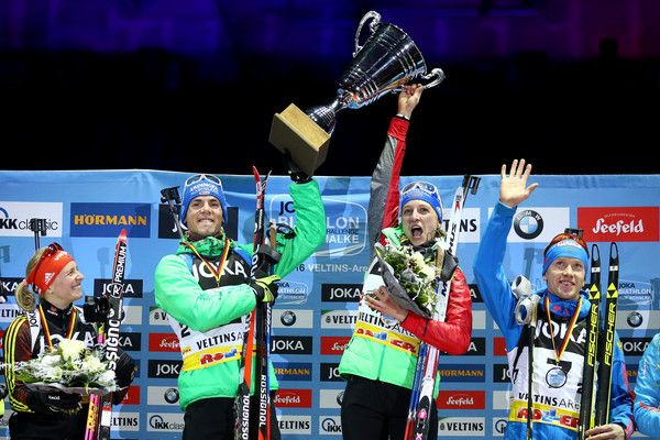 Simon Schempp of Germany (2nd L) and Vanessa Hinz of Germany (3rd L) lift the trophy on the podium after winning the JOKA Biathlon World Team Challenge 2016 at Veltins-Arena on December 28, 2016 in Gelsenkirchen, Germany.