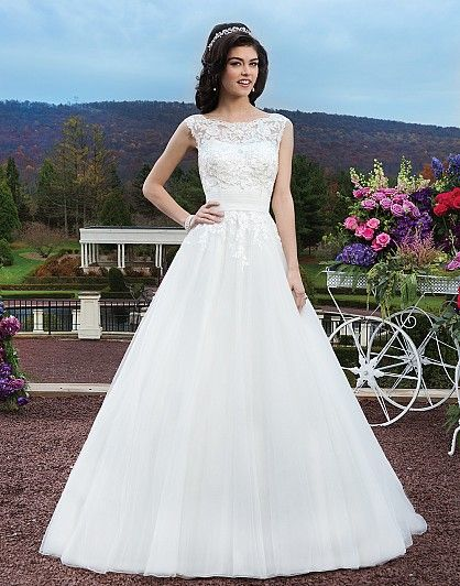 Sincerity / Wedding Dress / Style #3804 / Available Colours : Ivory, White - Venice beaded lace over tulle ballgown with a boat neckline and pleated tulle cummerbund at the natural waist. The gown is finished with a  V-back, tulle covered buttons to the bottom of the cummerbund and a chapel length train.