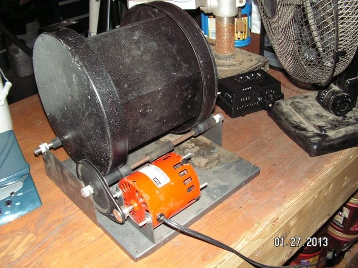 Rotary Tumbler by stilly -- Homemade rotary tumble constructed from an electric motor, steel plate, shafting, pulleys, and a drum. http://www.homemadetools.net/homemade-rotary-tumbler-3